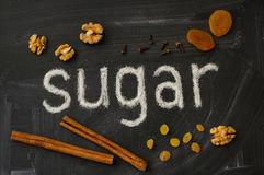 SUGAR letters, spices, draw fruits and walnut on a blackboard Stock Photos