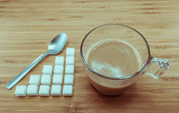 Sugar level for a cup of coffee for calories control Royalty Free Stock Photos