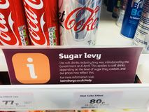 Sugar Levy Tax. Sign showing the governments new sugar tax levy in Sainsbury's supermarket, Knutsford, Cheshire, UK Royalty Free Stock Photo
