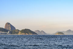 Sugar Loaf. Hill of Sugar Loaf and Guanabara Bay Inlet seen from the Copacabana beach Stock Images