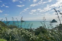 Sugar loaf islands at port Taranaki. Bright blue sea viewed from paritutu royalty free stock photos