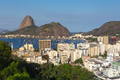 The Sugar Loaf Mountain and Botafogo, Rio de Janeiro. The famous Sugar Loaf mountain and the neighborhood of Botafogo with its buildings Royalty Free Stock Photos
