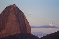 The Sugar Loaf mountain, Rio de Janeiro Brazil. The Sugar Loaf mountain with the full moon rising, Rio de Janeiro, Brazil Stock Image
