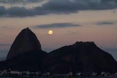 The Sugar Loaf mountain, Rio de Janeiro Brazil. The Sugar Loaf mountain with the full moon rising, Rio de Janeiro, Brazil Stock Photos