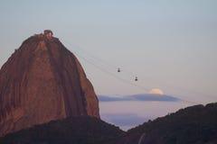 The Sugar Loaf mountain, Rio de Janeiro Brazil. The Sugar Loaf mountain with the full moon rising, Rio de Janeiro, Brazil Stock Images