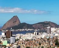 Sugar Loaf and social inequality. Rio de Janeiro. Landmark of Rio de Janeiro: Sugar Loaf. Also social inequality with poor communities and rich neighborhood royalty free stock photo