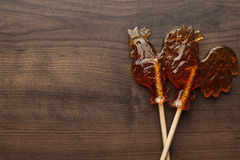 Sugar lollipop rooster shaped Royalty Free Stock Photo