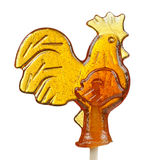 Sugar Lollipop in the Shape of Rooster on White Background Stock Photos