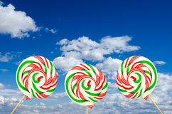 Three sugar lollipops in white green and red on background of sk Stock Images
