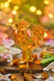 Sugar lollypop cockerel on a stick. Sweet cock on wooden background. Sugar lollipop in the shape of rooster. Vintage cock lollipops Royalty Free Stock Photography