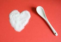 Sugar and love. A heart made of sugar Stock Image