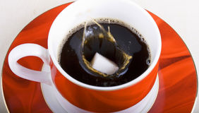 Sugar Lump Falling into Cup of Tea Stock Photo