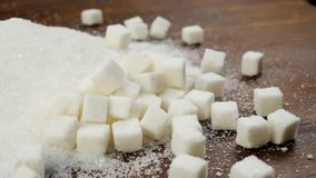 Sugar Lumps Scattered Onto Sand bianco Sugar On Brown Wooden Table stock footage