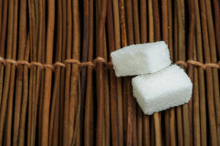 Sugar lumps on wooden base Stock Images