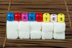 Sugar lumps and word diabetes Royalty Free Stock Image