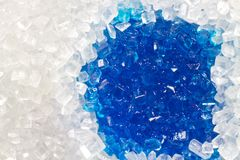 Sugar macro with a blue wet spot Royalty Free Stock Image