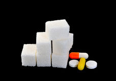 Sugar and medicines Stock Photography
