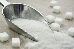 Sugar on metal scoop. Sugar on a metal scoop Royalty Free Stock Photo