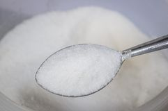 Sugar with metal spoon Royalty Free Stock Images