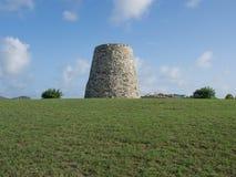Sugar Mill på en gräs- kulle arkivbild