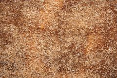 Sugar mixed with cinnamon scattered on the surface of the table.  stock image