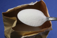Sugar out of the bag Stock Photo