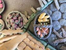 Sugar past figure. Marzipan vagetable. Carot, banana, basket, tree, apple, lemon, leaf Stock Photos