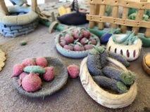 Sugar past figure. Marzipan vagetable. Carot, banana, basket, tree, apple, lemon, leaf Royalty Free Stock Image