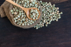 Sugar Pea Seeds in Gunny Bag with Spoonful Stock Photography