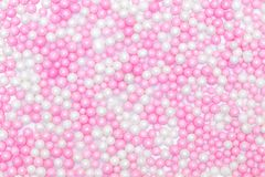 Sugar pearls background, colored white and pink, concept bakery. And toppings Royalty Free Stock Photos