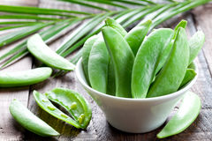 Sugar peas in bowl Stock Photo