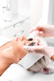 Sugar peeling, treatment in the beauty salon. Royalty Free Stock Photos