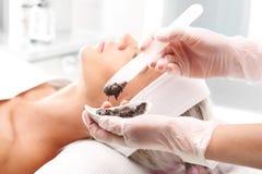 Sugar peeling, treatment in the beauty salon. Royalty Free Stock Photography