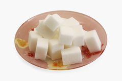 Sugar pieces on the plate Stock Photography