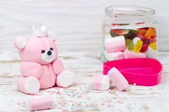 Sugar pink bear cub and candies in jar Stock Photos