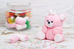 Sugar pink bear cub and candies in jar Stock Image