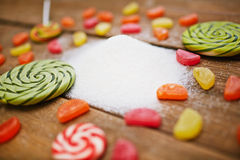 Sugar products. Candies, lollipops and pile of sugar stock image