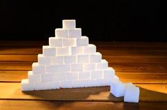 Sugar pyramid. A pyramid of sugar cubes Royalty Free Stock Image