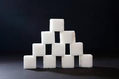 Sugar Pyramid On Dark Fotos de Stock