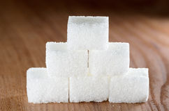 Sugar pyramid on wood Stock Photos