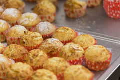 Sugar rain on muffins Royalty Free Stock Photos