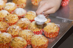 Sugar rain on muffins Royalty Free Stock Images