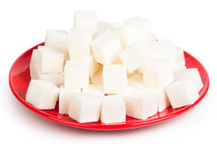 Sugar on a red plate Royalty Free Stock Photo