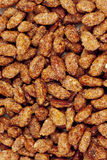 Sugar roasted almonds as background Royalty Free Stock Photography