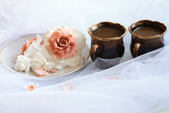Sugar rose to a cup of coffee on the veil Royalty Free Stock Photography