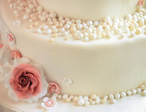 Sugar roses with pearls on the cake closeup Stock Images