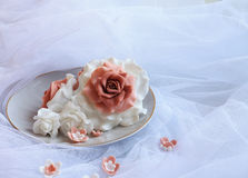 Sugar roses on a white veil Stock Photos