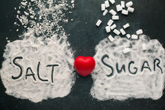 Sugar and salt brings harm to the heart. stock photography