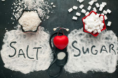 Sugar and salt brings harm to the heart. Sugar and salt brings harm to the heart, concept of healthy lifestyle without sugar and salt Stock Image