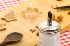 Sugar shaker and christmas cookies Stock Photos
